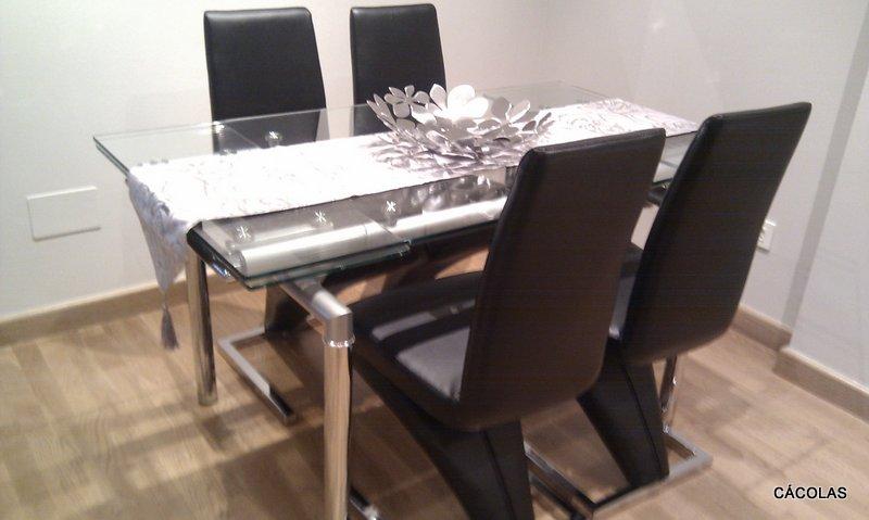 Mesa de comedor de cristal de 140*80 extensible a 190*80.