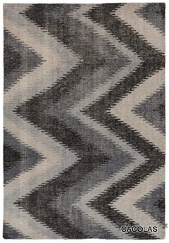 Alfombra dibujos geométricos, colores grises.