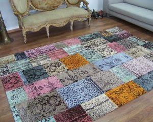 Alfombra de patchwork en colores .