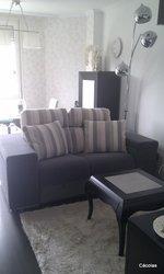 Sofá de tres plazas con dos asientos relax, tapizado en tela Mystic de Aquaclean.