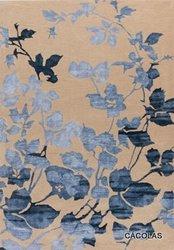 Alfombra lana con dibujo en contraste, tonos beig y azul.