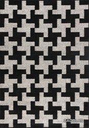Alfombra tejida en lana , dibujo en blanco y negro.